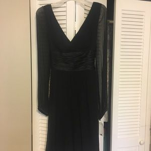 Black long sleeved cocktail dress